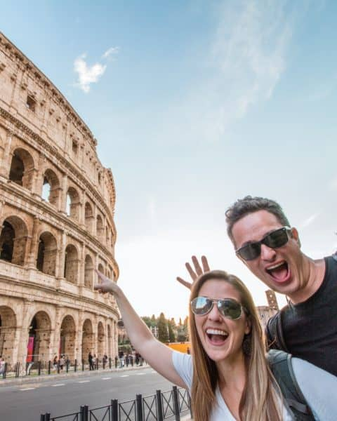 Photo of Greg and Hannah Wilnau pointing at coliseum